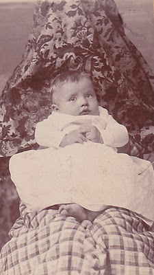 """Another spooky photograph: the """"hidden""""mother in plain view, holding her child still. Granville Hampton, and presumably his mother, Kate Cox Hampton"""