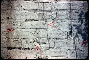 Elijah Harlan House, chimney.  Up arrow shows footprint of Atlanta B Harlan, left arrow says Feb 1823, down arrow says A B Harlan -- in effect a birth certificate in wet brick, fired  (Photo courtesy of Guy and Anna (Russell) Ingram, Danville, Ky).