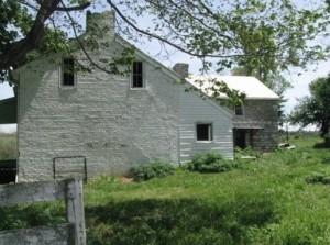 Elijah Harlan House with stone slave quarters on right (Photo by the author, April, 2012)
