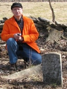 The author at two of the three extant headstones, B F (standing) and T J lying at my knee. The stone of W M is to my right, leaning against a tree. Broken stubs of dressed stone indicate more burials, the dry stone wall may contain more headstones or remnants. A seriously endangered cemetery.