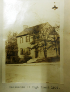 This picture of Hugh Brent's house was recently found in a notebook compiled by Edna Whitley, Bourbon County historian, and kept in the archives of Hopewell Museum in Paris, Kentucky. Mrs. Whitley noted that the house was torn down in 1920, but she preserved this photograph in a lecture she gave which is included in the notebook. This lecture was also an article in the Kentucky Register (Mrs. W.H. Whitley, A Glimpse of Paris in 1809, Register of Kentucky State Historical Scoiety, Vol 20, No 58 January, 1922 pp. 49-57), but was not illustrated. This house is known as the first brick house in Paris, but the site is now a vacant lot at the corner of 2nd and Main Streets.